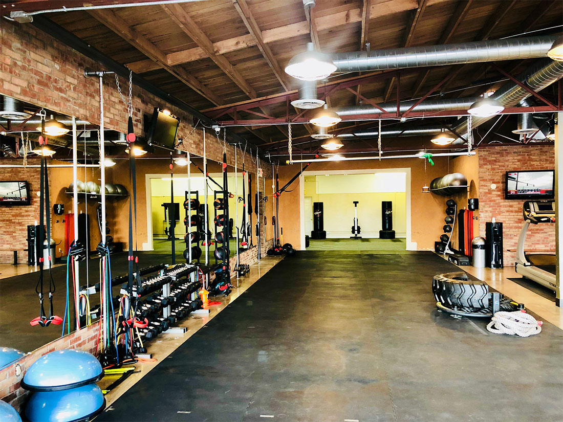 photo 1 of FIIT by Jason Smith facility showing bosu balls, dumbbell racks, medicine balls, resisitance bands, TRX bands, chin up bar, treadmill, punching bags, tire flip, battle ropes and more to help you meet your weight loss goal