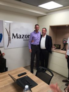 "Dr. Lewin with Doron Dinstein, MD, MBA. Dinstein is the CMO of Mazor Robotics. A medical doctor with an MBA, he is part of the medical and business ""brain trust"" of the company."