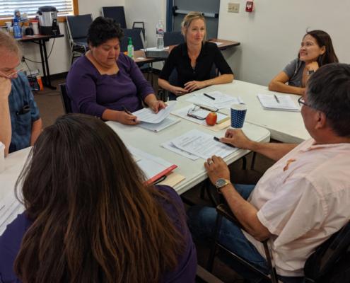Educators sitting at table at Teaching Native Waters workshop