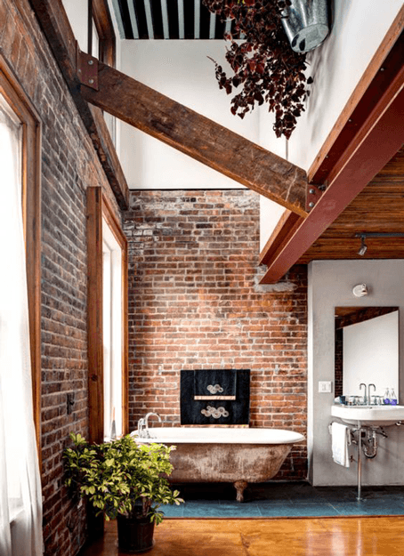 loft bathroom with red brick walls