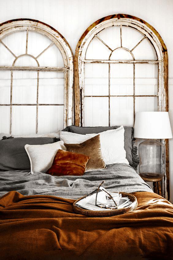 white bedroom with copper orange bedding