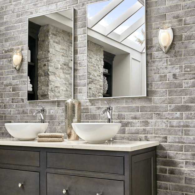 bathroom with taupe brick accent wall