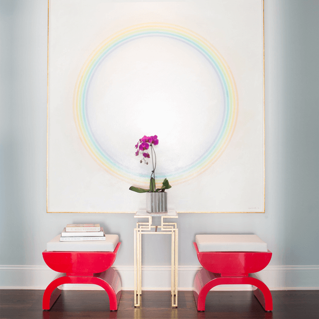 art deco style interior with bright red stools