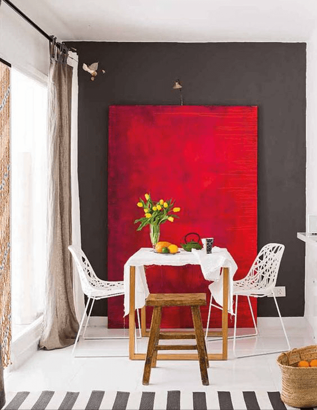 gray and white dining room with bright red accent panel