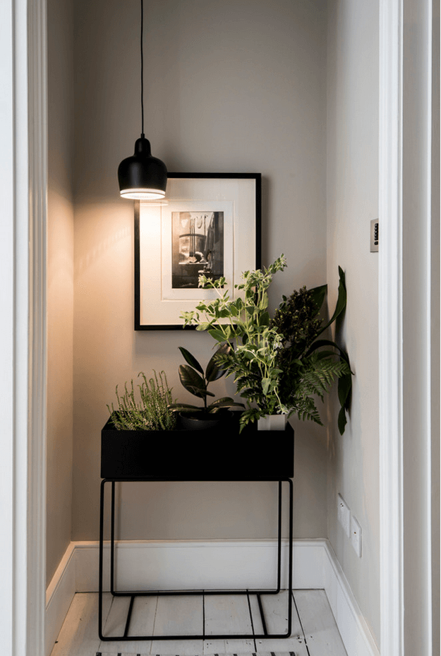 light taupe hallway with black and white accents