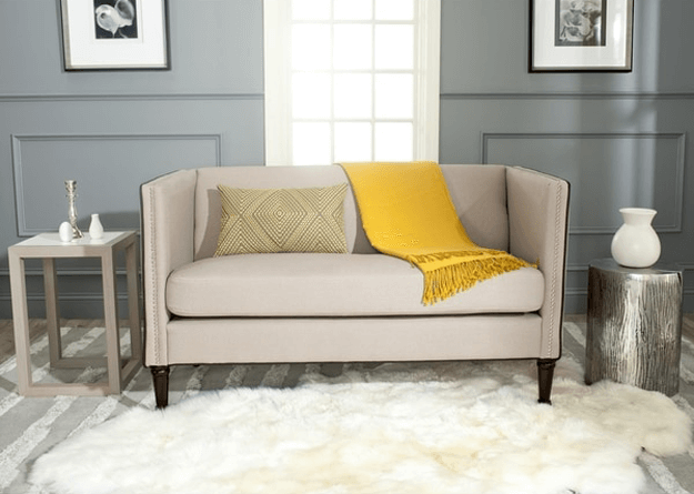 light taupe sofa with golden yellow accent
