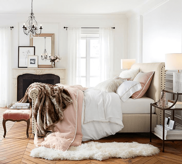ivory sheepskin rug in traditional bedroom