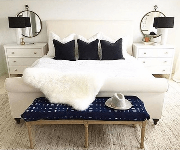 ivory white sheepskin throw in contemporary bedroom