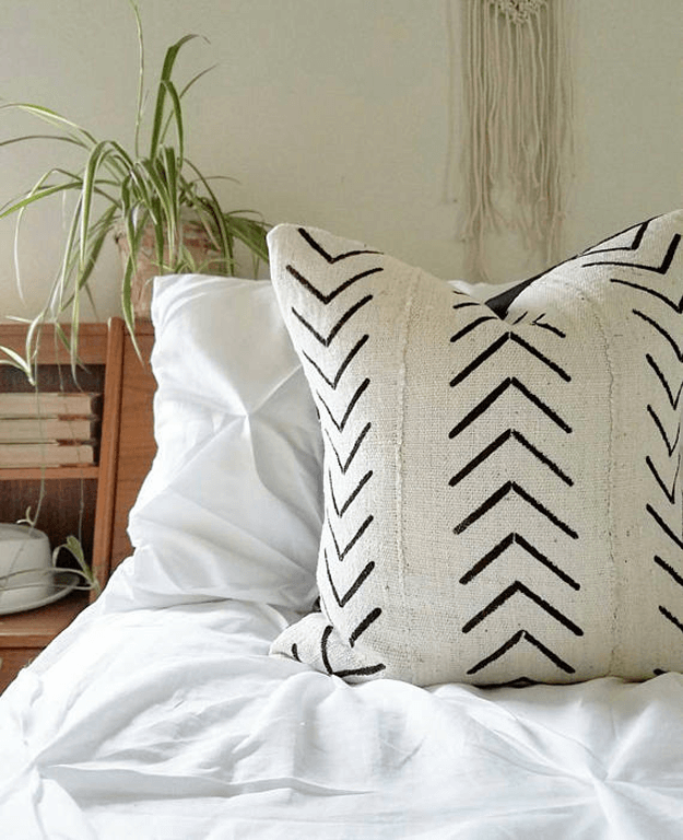 white african mudcloth tribal pillow on bed