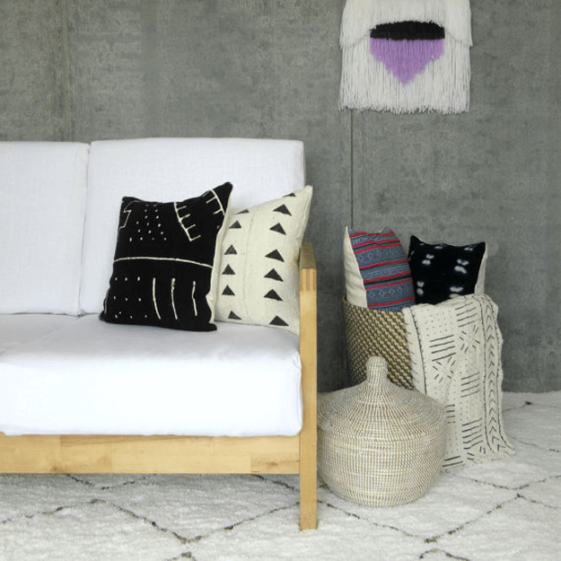tribal style living room with mudcloth pillows