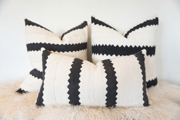 white mudcloth with black zig zag stripes pillow