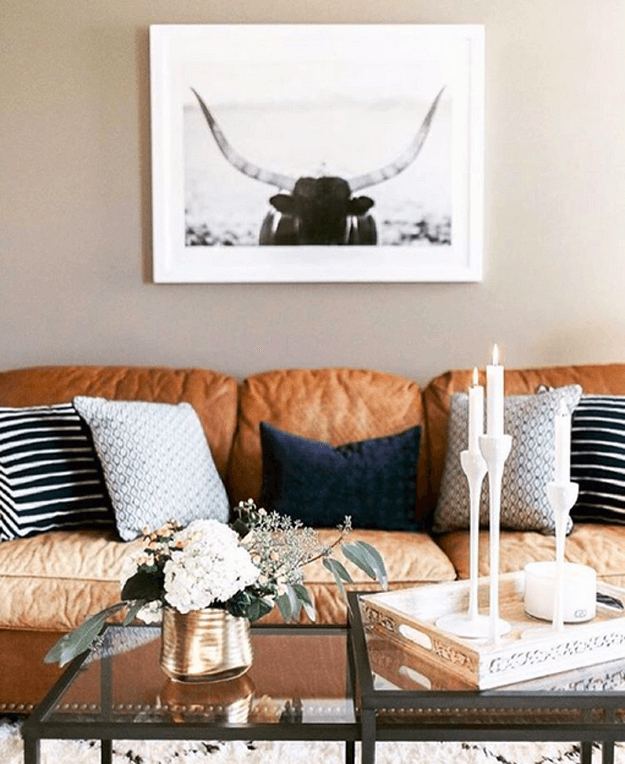 camel brown leather sofa with steer photo above