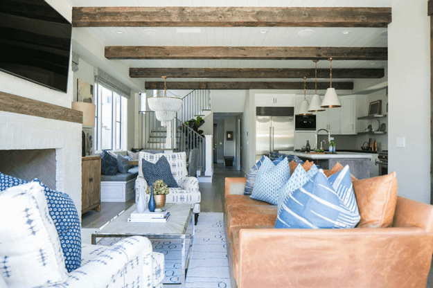 living room with camel brown leather sofa and denim blue accents