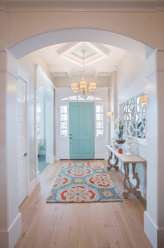 white home foyer with light turquoise door