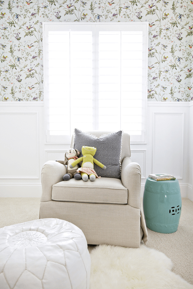 white interior with floral wallpaper and teal accents