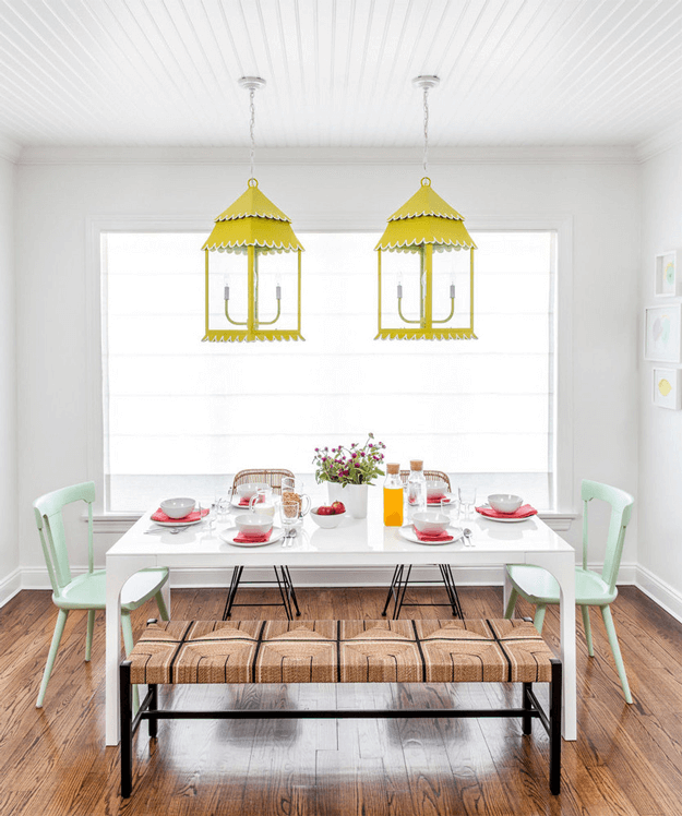 eclectic dining room with lemon yellow lantern pendants