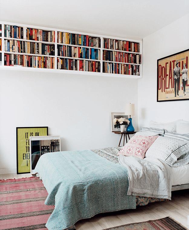 white minimalist bedroom with light turquoise blanket