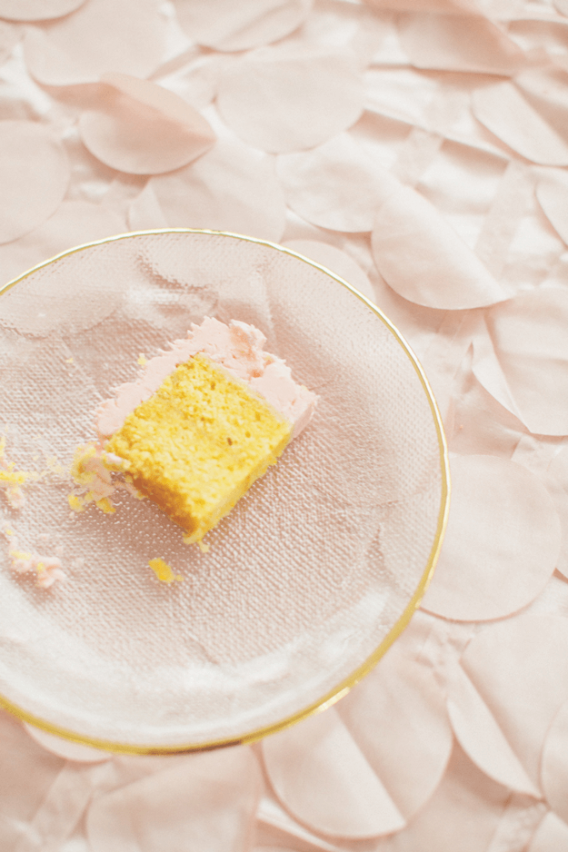 yellow cake with blush pink icing