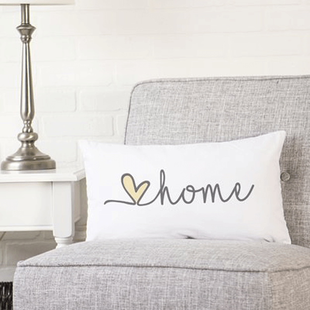 white pillow with home cursive writing