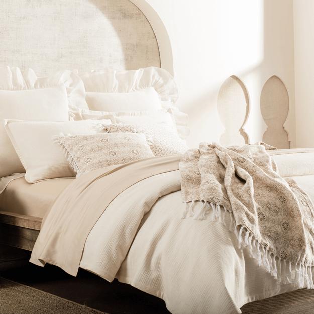 beige bedding set in cream room