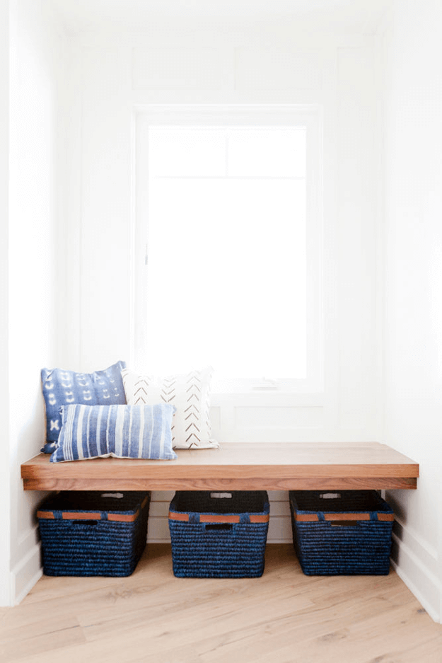 white interior with wood bench seat