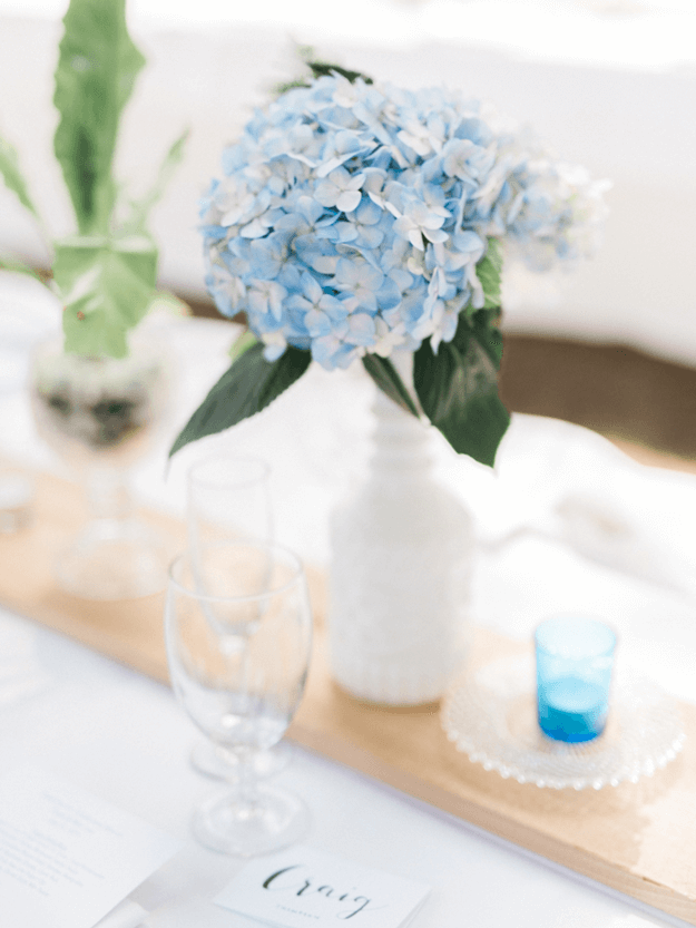 blue and white flowers on wedding table