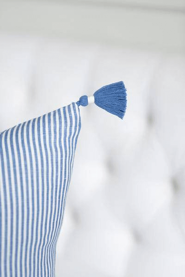 french blue striped pillow on white chair