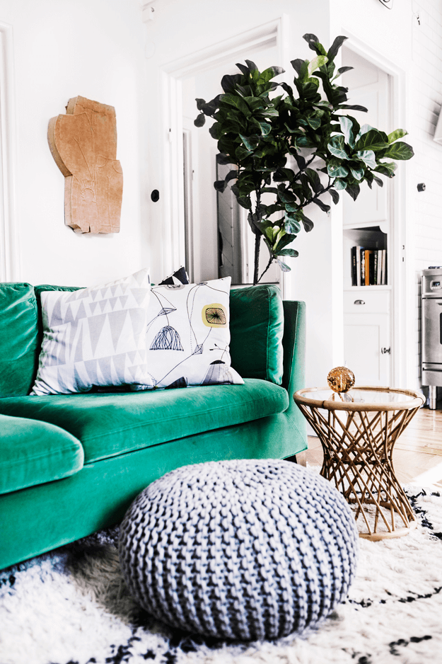living room with emerald green sofa
