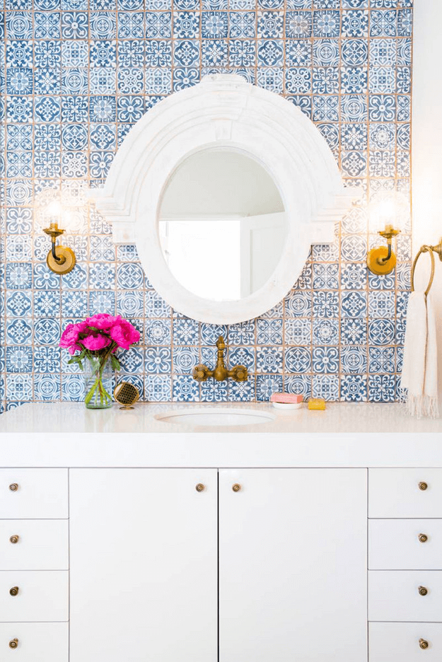 white bathroom with blue Moroccan tiles