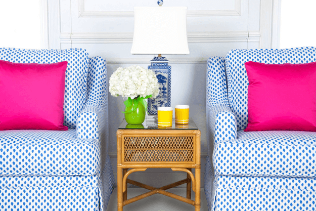 blue spotted print club chair with hot pink pillow