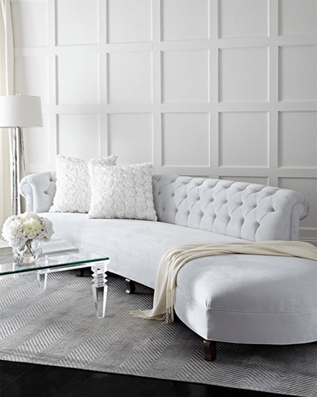 pale blue tufted curved sofa