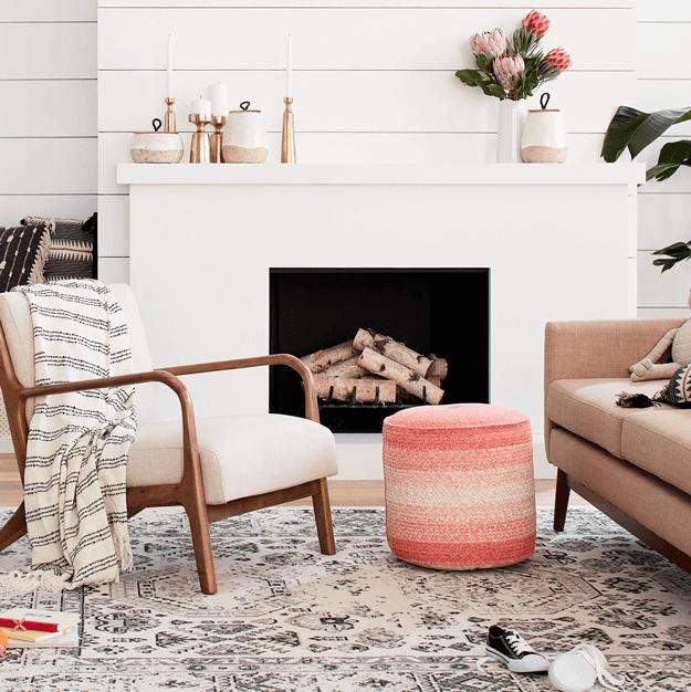 coral peach braided pouf ottoman in white living room, coral decor, coral color