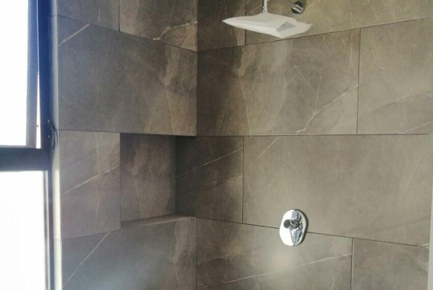baño acabados arbolada