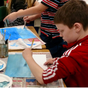 kids creating artwork with paints