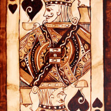 "Angel Sarkela-Saur created this original ""Jack of All Coffee"" Coffee Art® painting. It features a Jack playing card holding a cup of coffee."