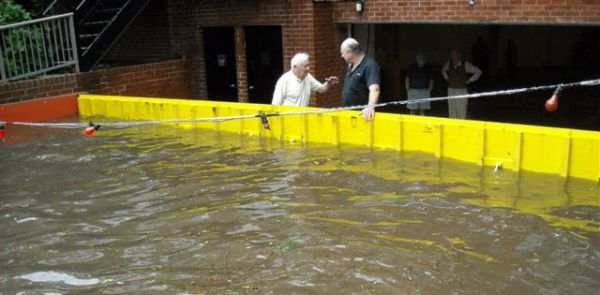 Residents of this NY apartment are glad that their vehicles are protected from flood damage behind a FloodBreak Automatic Floodgate.