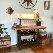 a wine rack with a desk lamp on top