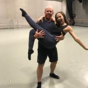 a man holding a dancer
