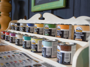 A display for cans of Black Dog Salvage's signature furniture paint line