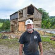 Mike Whiteside outside a barn