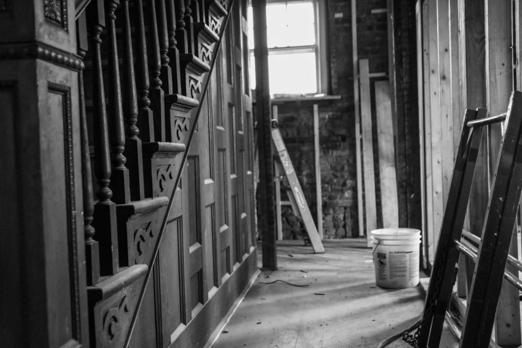 an image of the staircase in the Stone House before the renovation