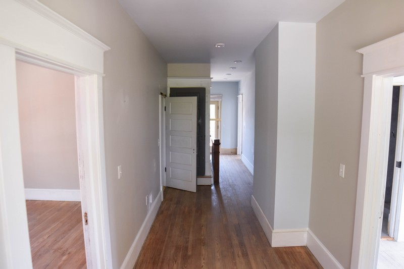 an unpainted hallway in the Stone House