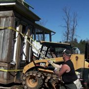 a bobcat is used to salvage the Izard House