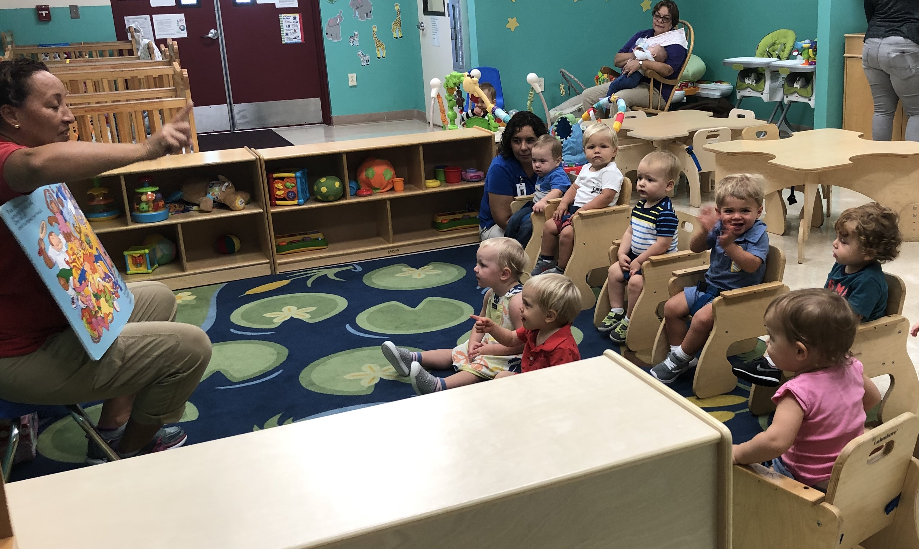 holycross-kids-being-read-to