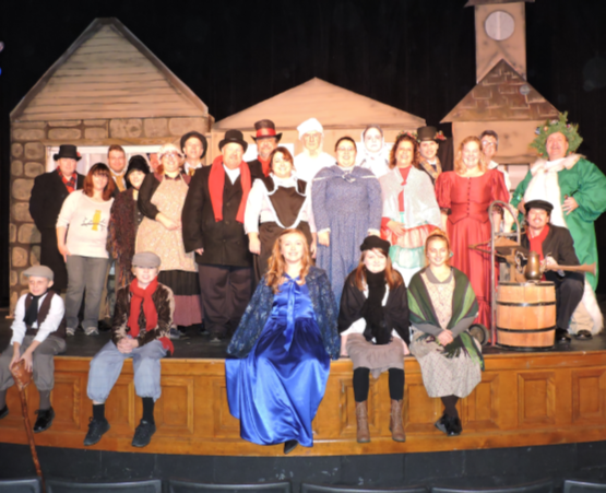 A picture of the cast of A Christmas Carol