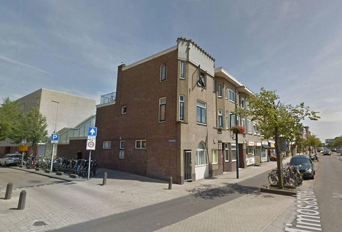 street-art-utrecht-apartment-building-transformed-into-bookcase-jan-is-de-man-5cadd0d63f077__700