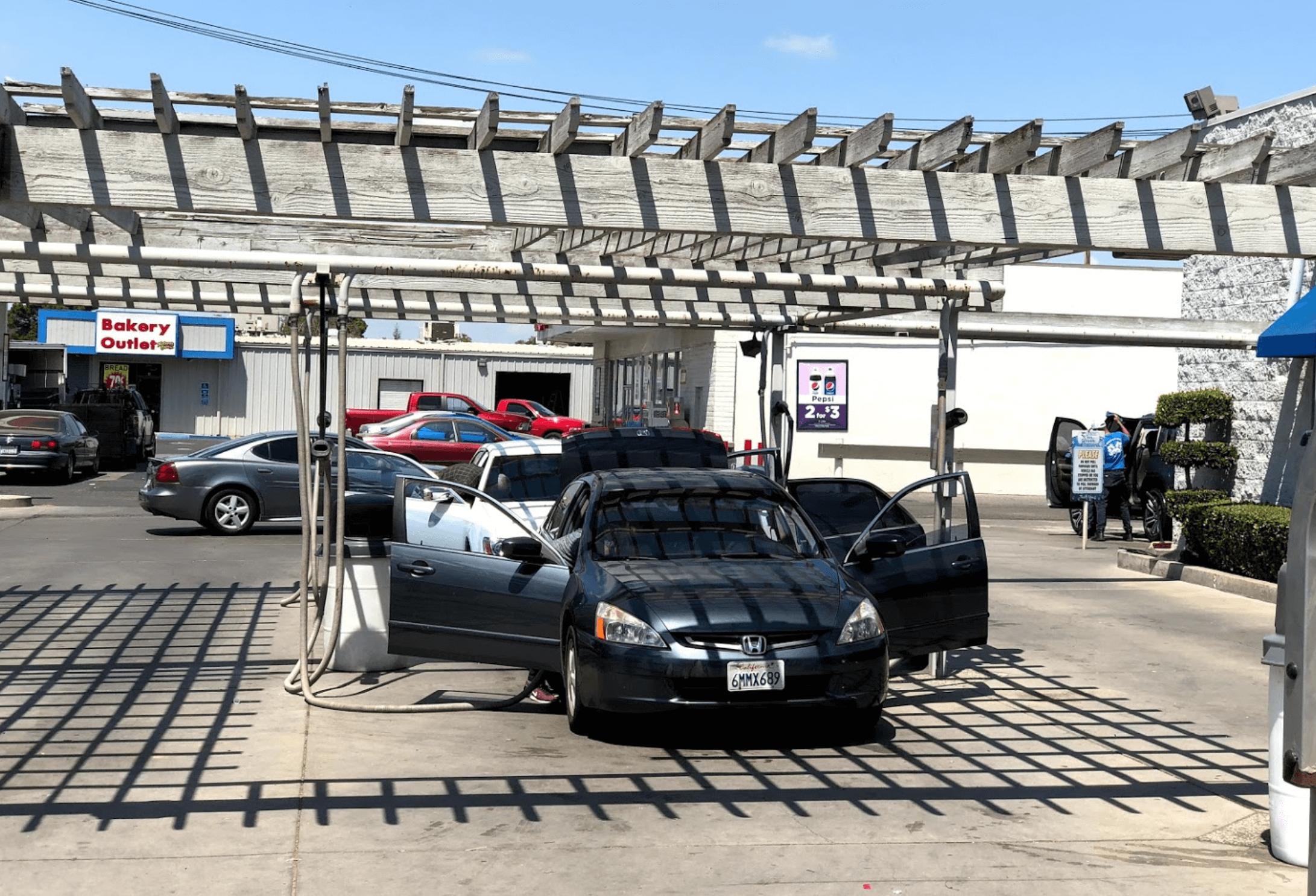 Cars being vacuumed