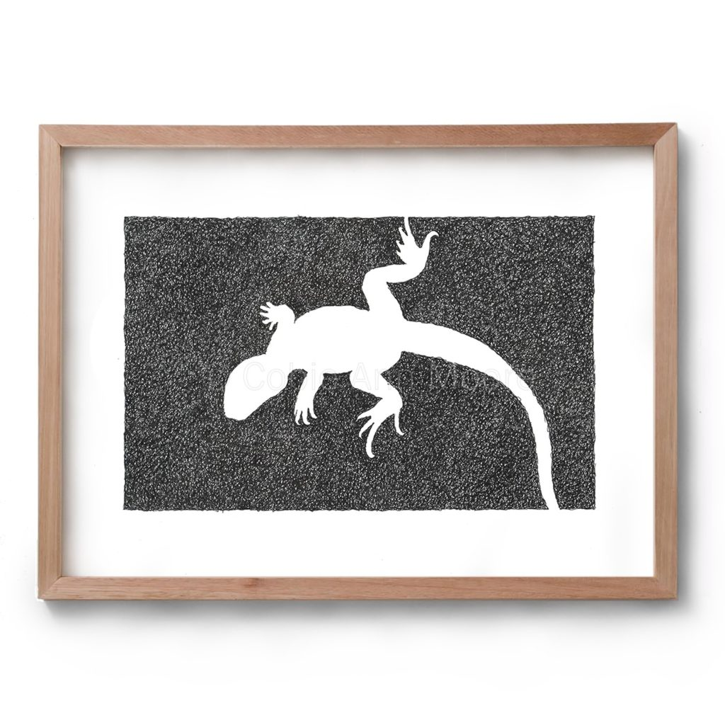 Black and white drawing by Cobie Ann Moore of a Lizard framed in a simple wooden frame