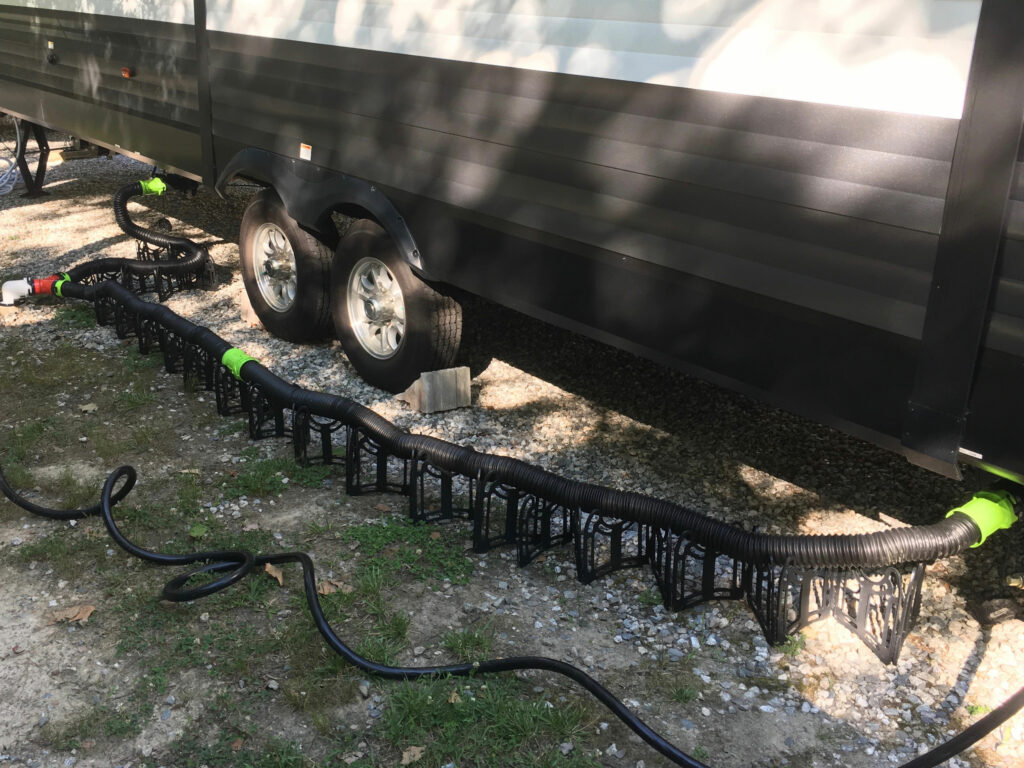 RV sewer hose connection toward front of camper