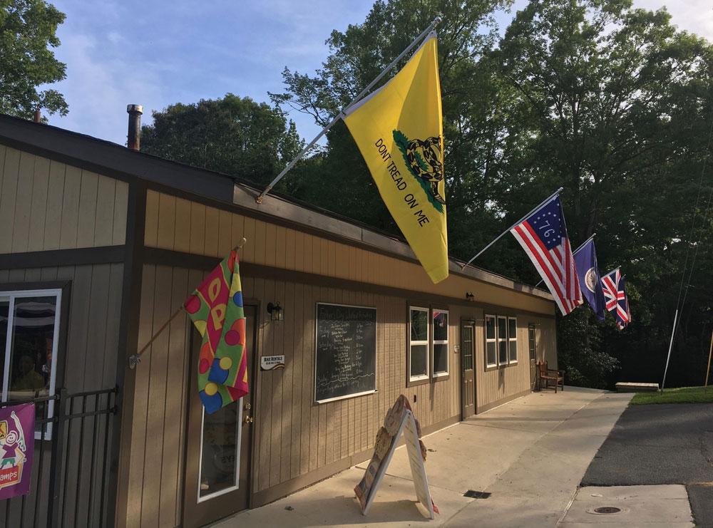 KOA Williamsburg VA building with flags